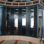 curved indoor water wall lobby entrance glass stone waterfall fountain