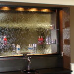 glass waterfall bar with drink shelves