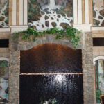 indoor custom home waterfall feature marble tiered