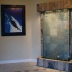 indoor stone backing with glass waterfall fountain