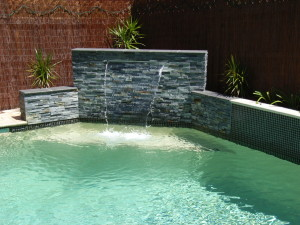 Stack stone feature wall with sheer descent waterfall