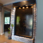 indoor custom water wall with lighting black trim