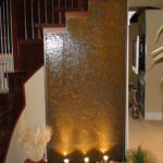 indoor stone stairwell water wall fountain